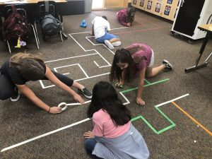 students creating dash maze