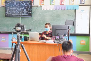 teacher doing in-class and virtual learning