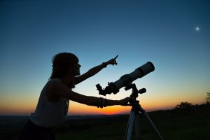 astronomy scientist looking at moon