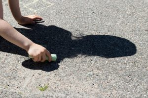 child outline shadow with chalk